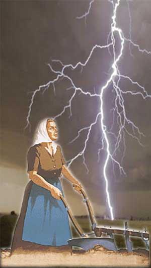 Mujer mirando a la tormenta mientras ara